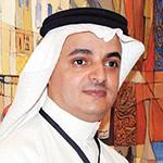 الفنان فهد خليف أمام لوحته