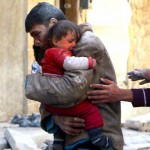 A boy holds his baby sister saved from under rubble, who survived what activists say was an airstrike by forces loyal to Syrian President Bashar al-Assad in Masaken Hanano in Aleppo