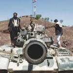 حوثيون-يقفون-على-دبابة-150x150